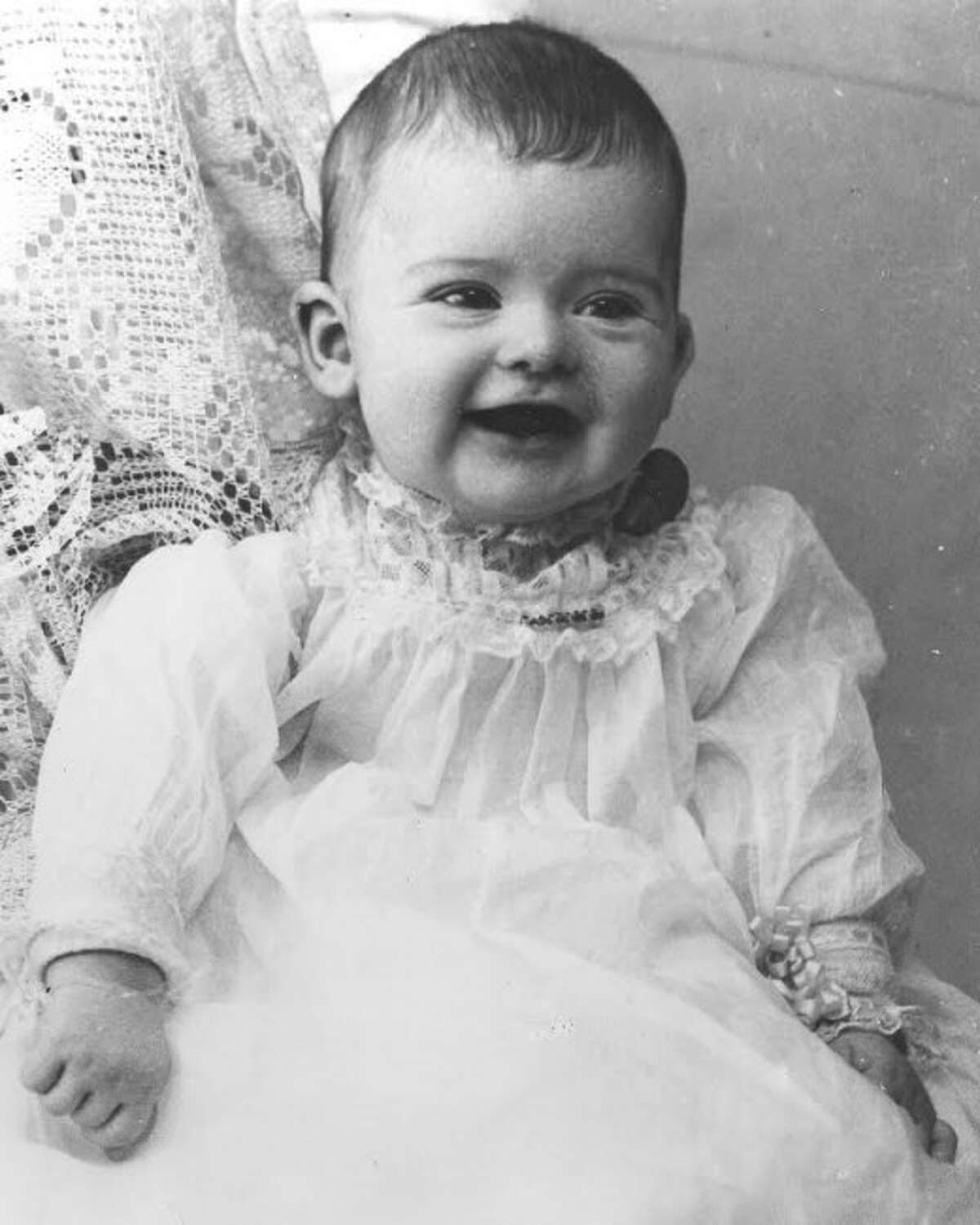 Virginia Buckley, pictured as a child in 1896 and an adult in 1923, was the only child of Manistee lumber baron, Edward Buckley.