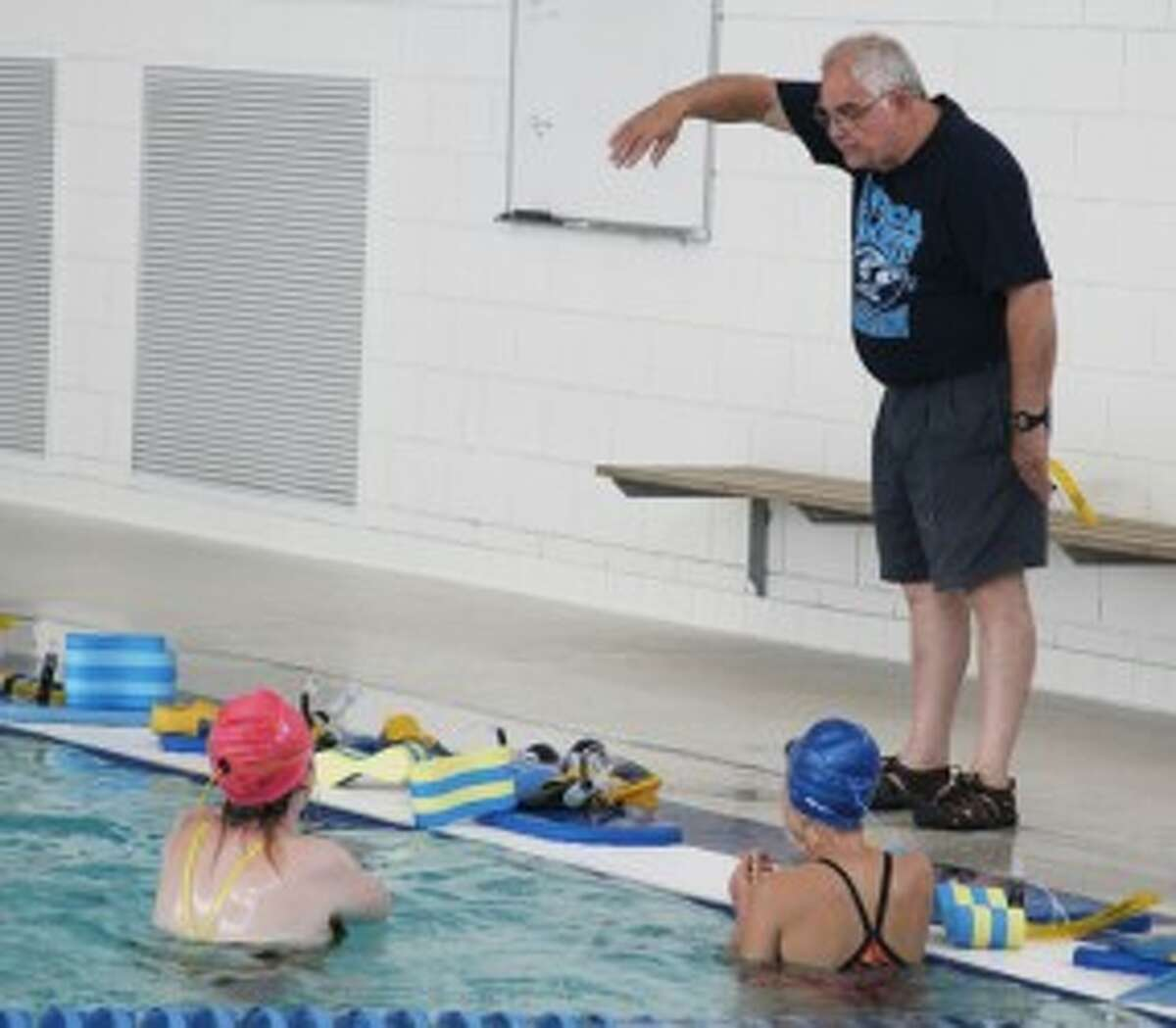 Manistee swimming coach Corey Van Fleet gives instructions during Wednesday's afternoon's practice. (Dylan Savela/News Advocate)