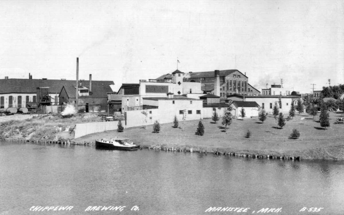 This photo, taken in the 1940s, shows Manistee's original Douglas Park, to the right of the Chippewa Brewing Company. Eventually the city sold the property, but later named First Street Beach in honor of lumberman William Douglas. (Courtesy Photo/Manistee County Historical Museum)