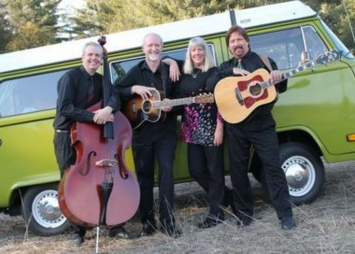 The group Peter, Paul & Mary...remembered, in front of its bus, includes Dave Swan, Lawrence