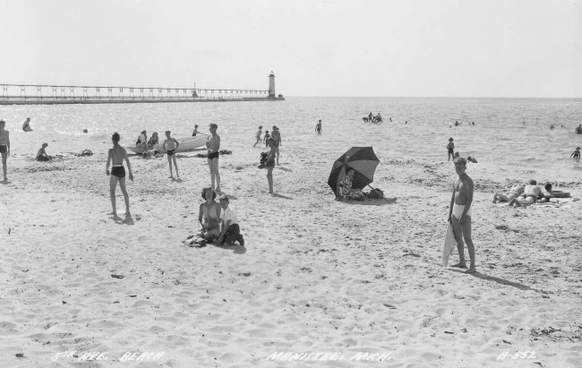 Nothing could beat a summer day at the beach in Manistee in the early 1950s.