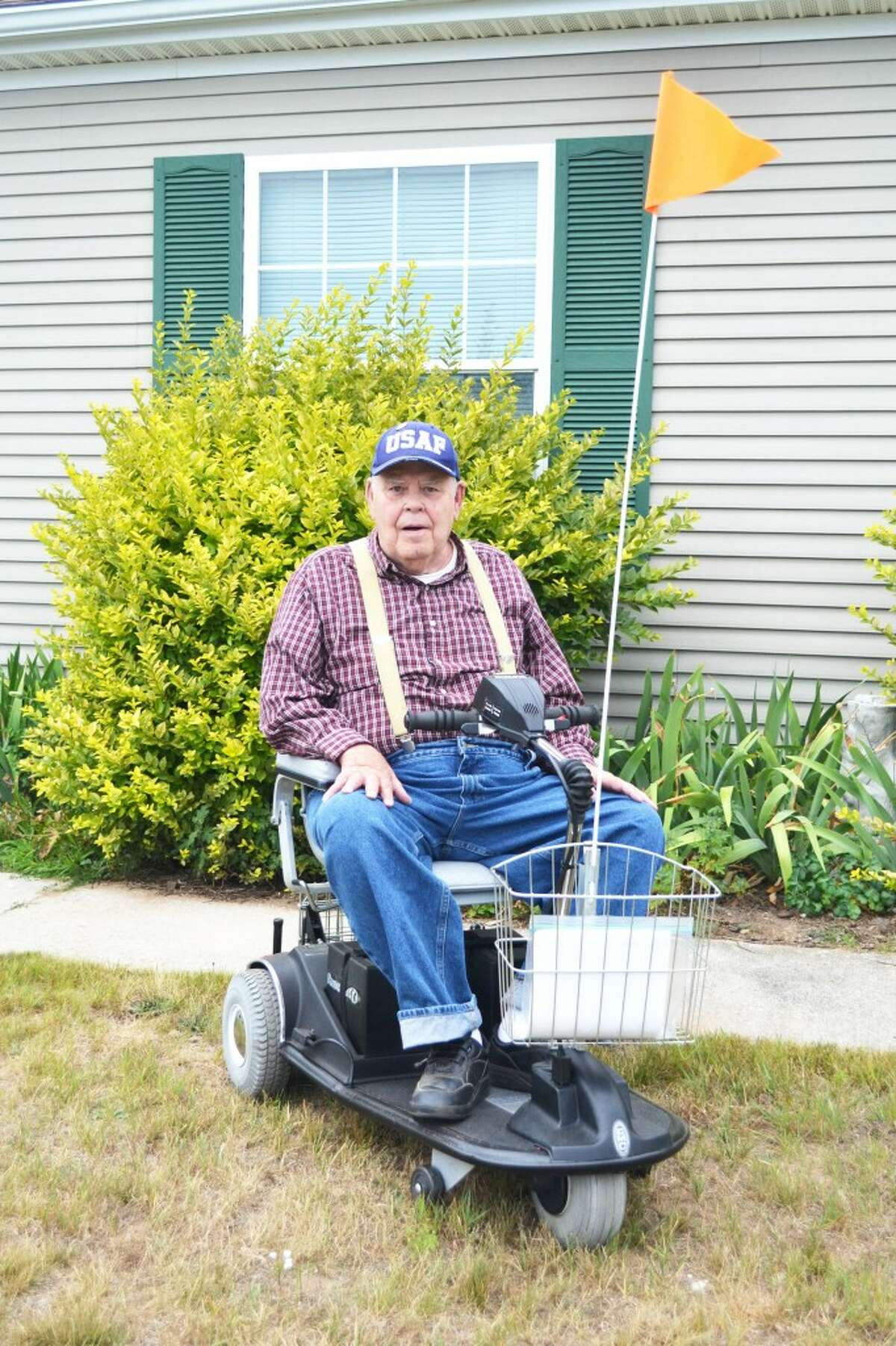 LIMITED MOBILITY: John Harwell's mobility is limited by a progressive nerve condition affecting his legs.