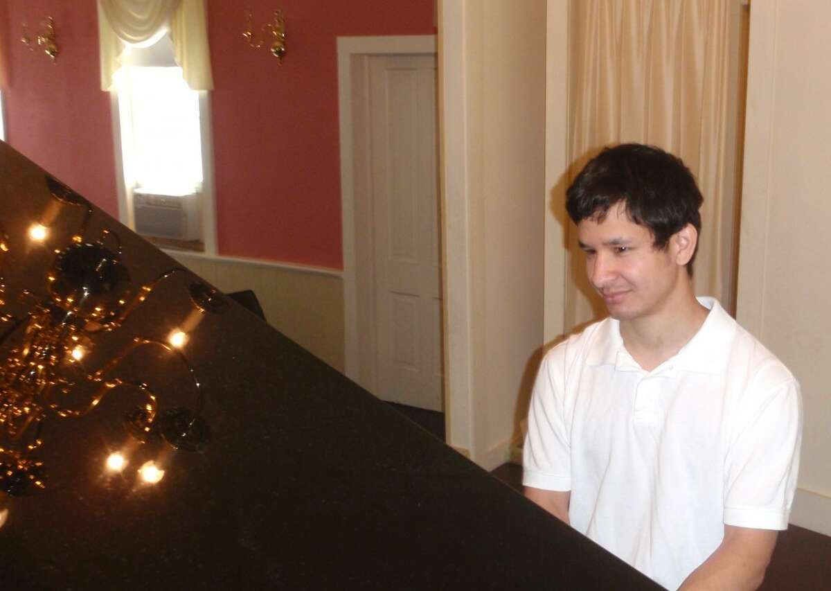 David Michael Fisher, a graduate of Manistee High School and Western Michigan University, will perform on Sunday, Aug. 11 at 3:30 p.m. at the Music House, 302 Walnut St., in Manistee. (Courtesy Photo)