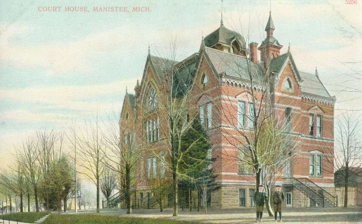 The Manistee County Courthouse building is depicted in this early 1900 postcard.