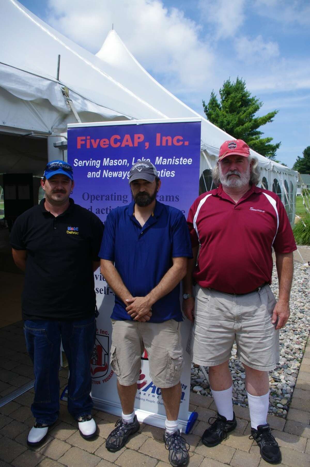 Members of the first place team at the FiveCAP Golf for Warmth event, finishing with 60 strokes, are (from left to right) John Sobaski, John Larr and Phil McKie. Not pictured is Kenner McKie. The outing was held at Manistee National Golf & Resort. (Dave Yarnell/News Advocate)