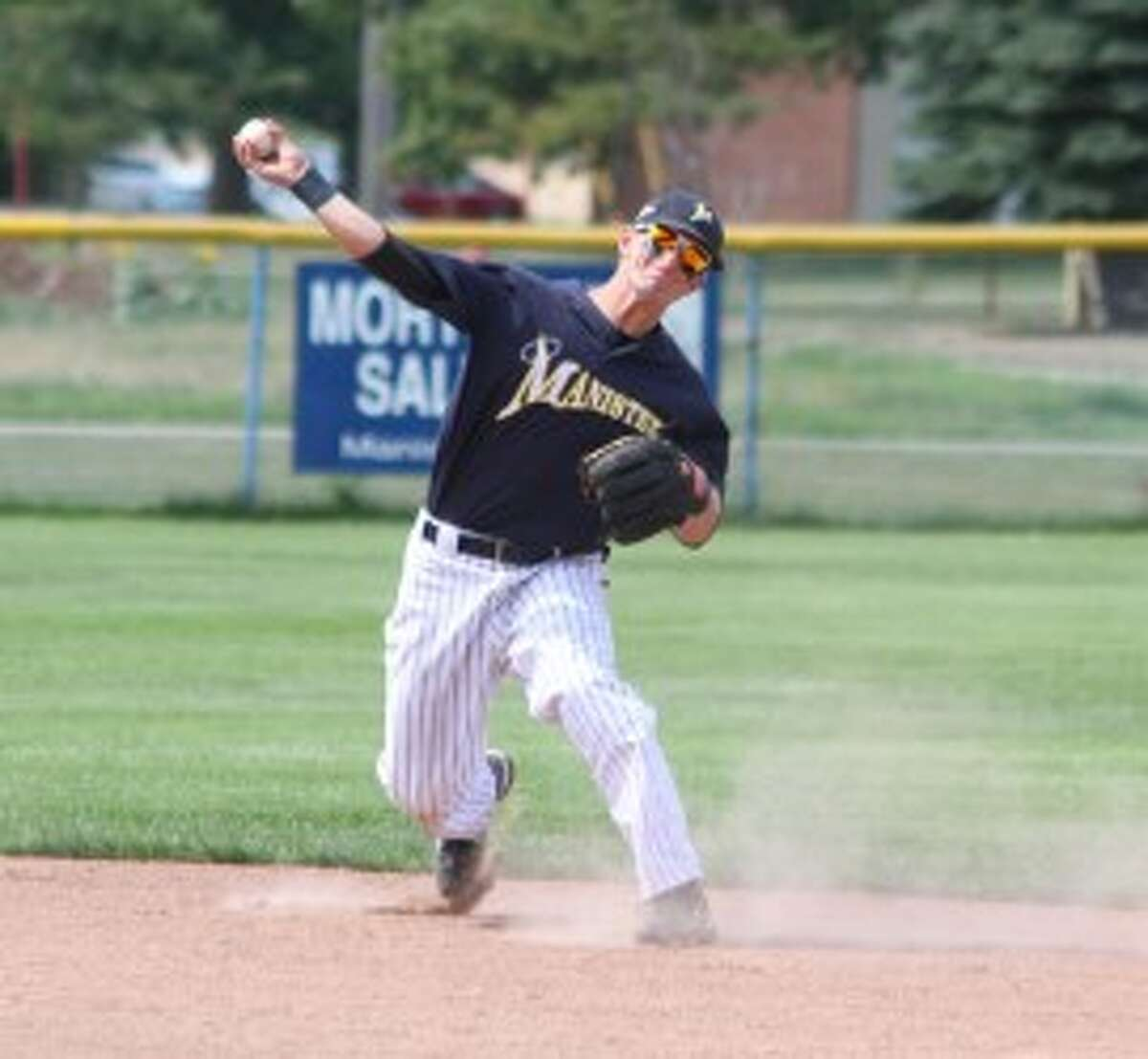 Saints second baseman Josh Ledford throws to first for an out in the nightcap of Sunday's sweep of Coleman in Manistee's regular season finale at Rietz Park. (Matt Wenzel/News Advocate)