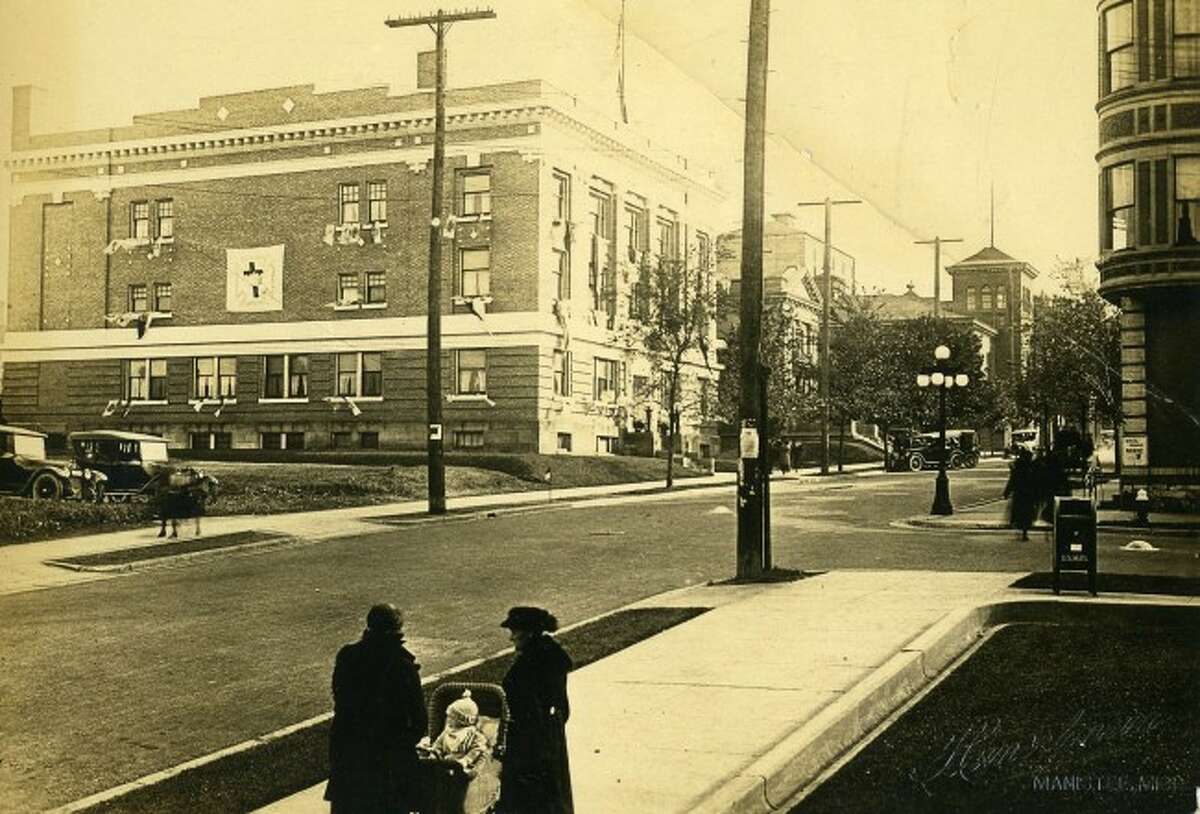 This 1920s view shows Maple Street looking up from the current location of City hall with the Masonic Temple and library in the background.