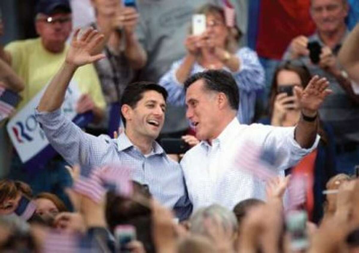 Republican vice presidential candidate Paul Ryan of Wisconsin (left) and Republican presidential candidate Mitt Romney wave to the crowd on Sunday at the Waukesha County Expo Center in Waukesha, Wis. (MCT News Service Photo)