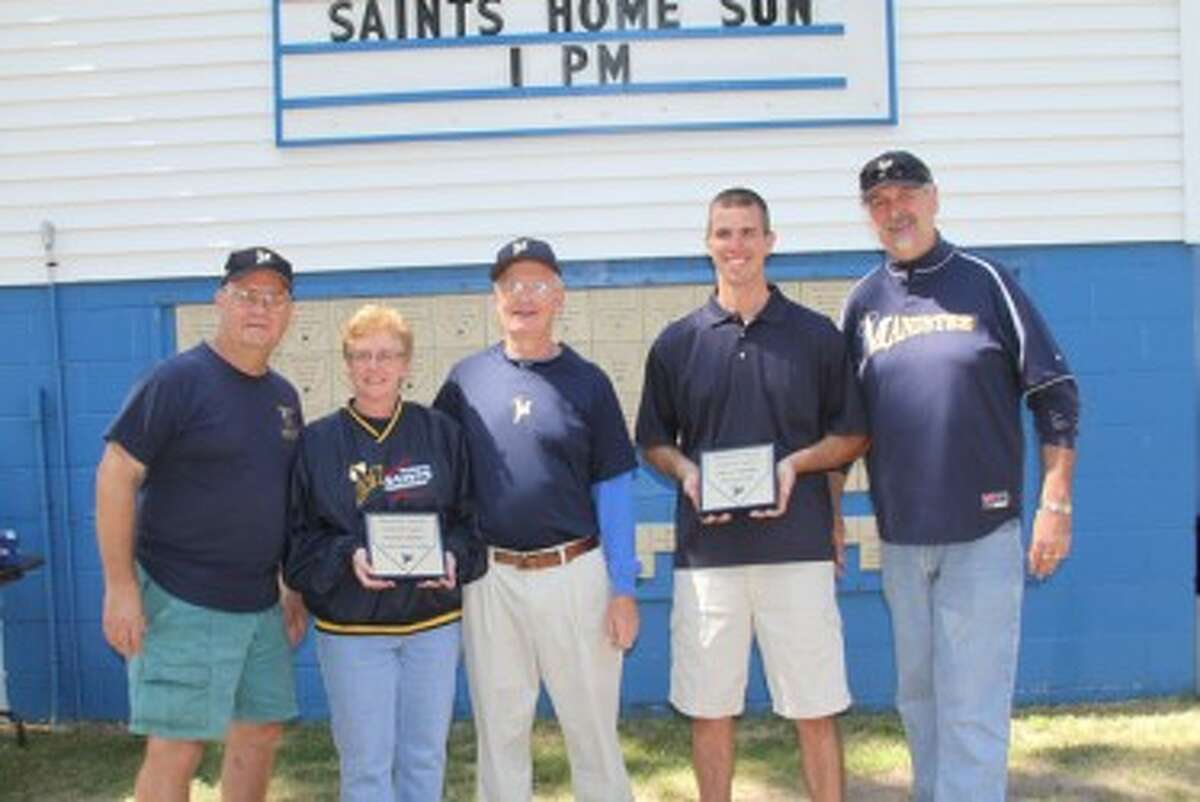 Pictured (from left to right) Saints board member Mike Gielczyk, Hall of Fame inductee Marilyn Kliber, board member and manager Phil Kliber, Hall of Fame inductee Steve Opalka and team president Gary Makowski pose during a Hall of Fame ceremony on Saturday at Rietz Park. (Matt Wenzel/News Advocate)