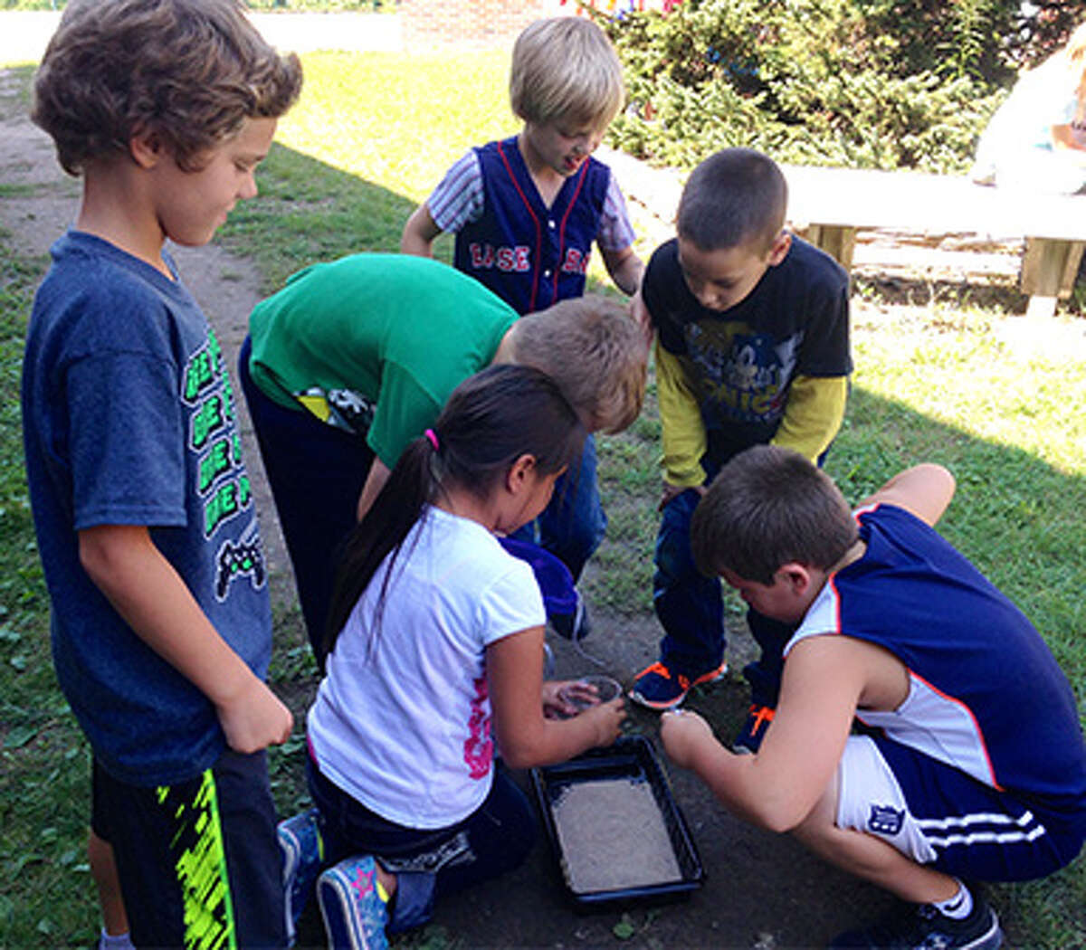 In a lesson on the Earth's Surface, students examined photos of the Grand Canyon to discover the effects of natural forces on the land and then conducted an experiment of a stream to model the effects of water on the earth's surface.