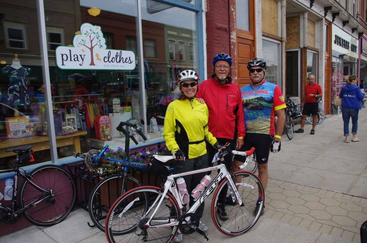 Chicagoans Dani Peterson and Dan Josephities along with Ralph Hall, of Philadelpia, have done a number of Michigan bicycle tours, and on Monday in Manistee they took a break from the League of Michigan Bicyclists 27th Annual Shoreline West Bicycle Tour. (Dave Yarnell/News Advocate)