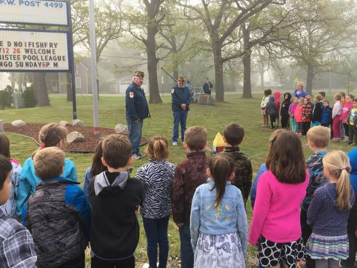 Manistee Veterans of Foreign Wars Walsh Post No. 4499 commander Don Vadeboncoeur speaks to Madison Elementary students on the importance of Memorial Day.