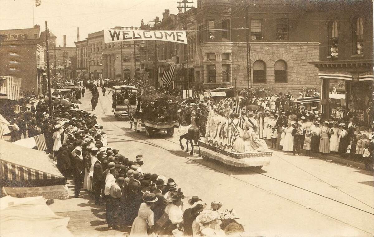 An early 1900s photo of a parade on River Street in Manistee. (Courtesy Photo/Dale Picardat)