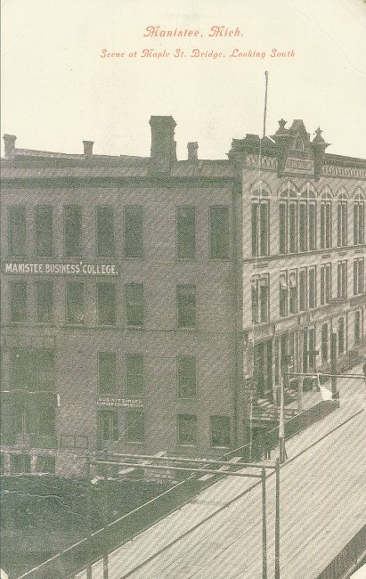 The Manistee Business College is shown in this postcard depiction in the early 1900s. The view is from the Maple Street Bridge looking south.