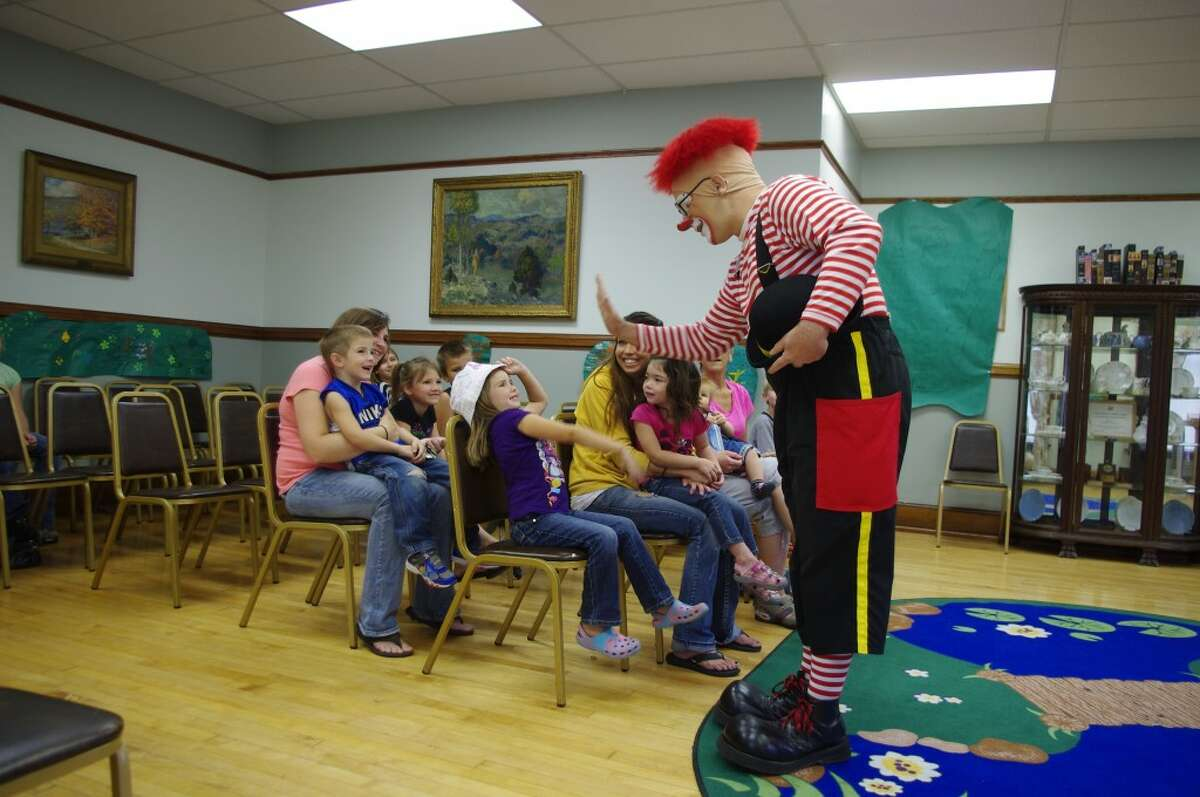 Kelly Miller Circus clown J.P. Ballyhoo used audience participation to keep a group of kids entertained at the Manistee Library on Tuesday afternoon while he talked about the circus that is coming to Manistee on Aug. 21. There will be two performances on grounds at the Manistee industrial park, at 4:30 p.m. and 7:30 p.m. (Dave Yarnell/News Advocate)