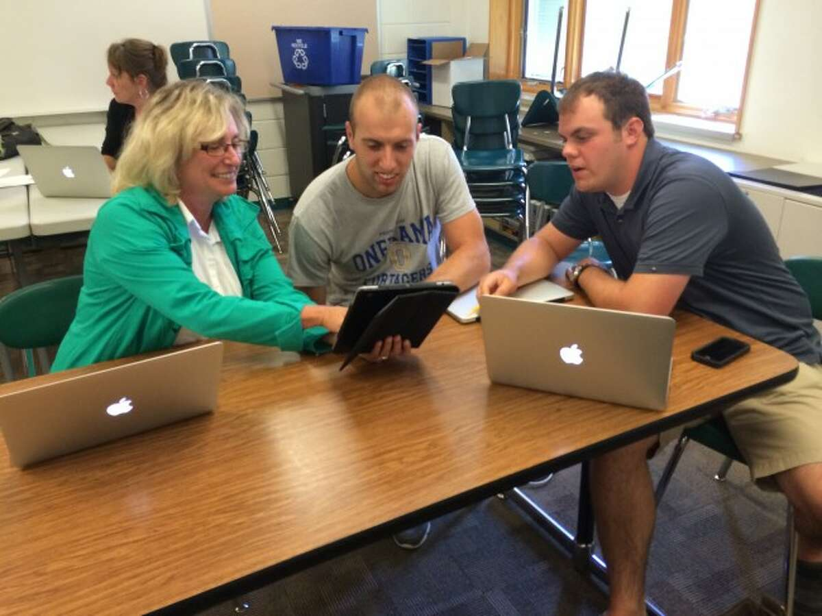 One of the things Onekama School officials hope will happen is the new one-to-one computer program will help keep their students moving forward to avoid slipping back into Focus School status. Onekama teachers Michele Warman, Kevin Hammar and Eric Piccard test new resources in the one-to-one computer program.