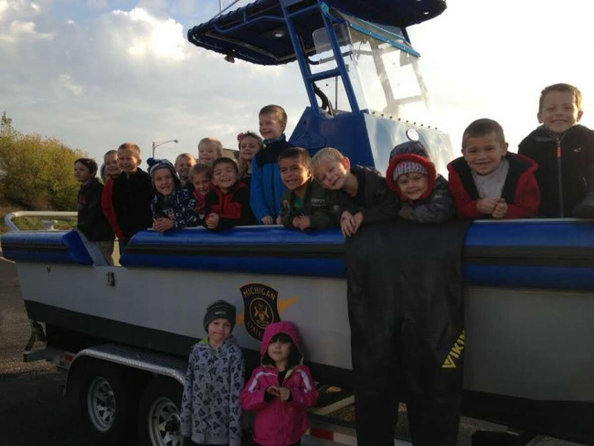 Officials at Madison Elementary school will be holding fundraisers in the next two weeks that they hope will provide funds for student field trips like this one to view the Manistee Sheriff's Department rescue boat and for the purchase of playground equipment.