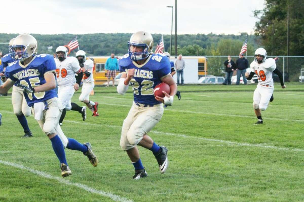 News Advocate file photoOnekama running back Jon Acton runs for a touchdown against Mesick. The Portagers are preparing for Central Lake tonight in the opening round of the playoffs.