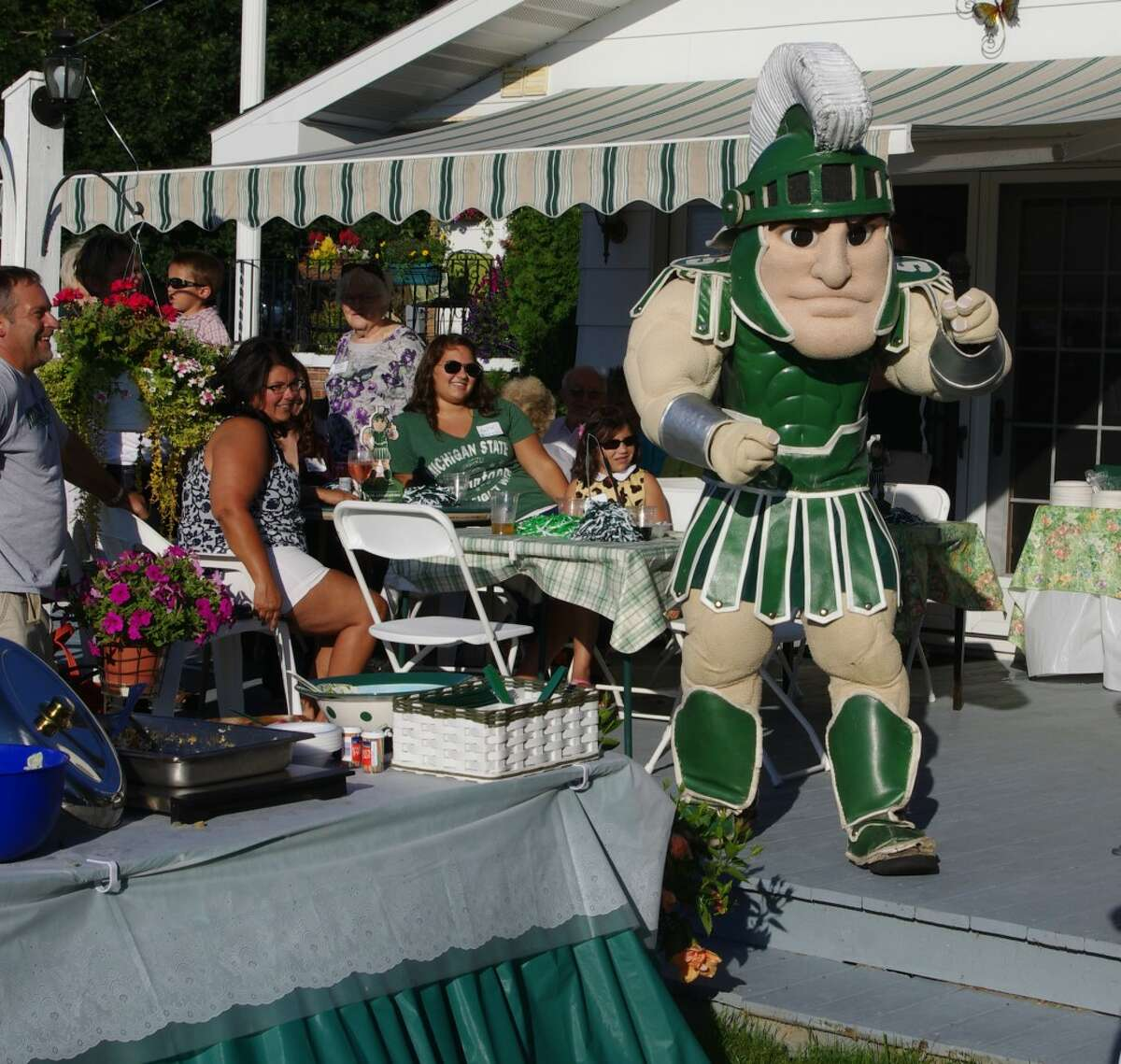 The Michigan State University mascot Sparty was the guest of honor at the 13th annual Michigan State University Alumni Club of Manistee barbecue held at the Lutz Farm near Kaleva on Wednesday evening. (Dave Yarnell/News Advocate)