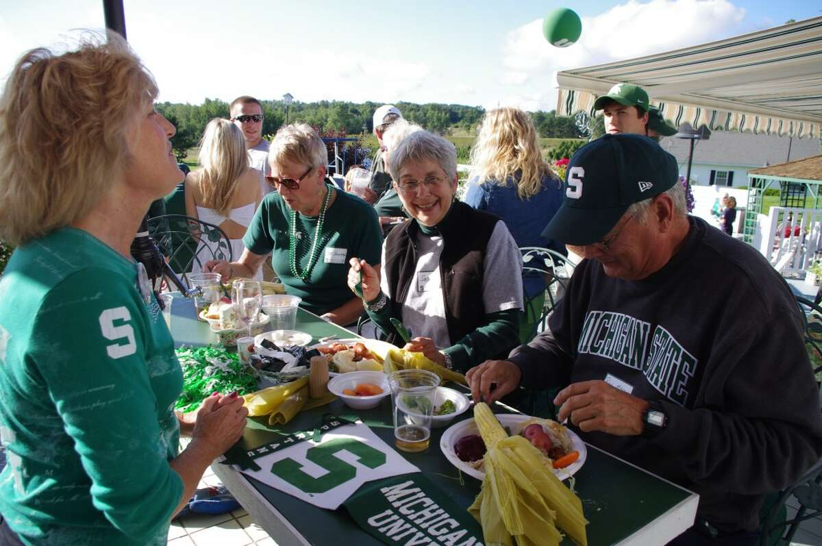 There was green and white everywhere at the Michigan State University Alumni Club of Manistee barbecue held at Lutz Farm near Kaleva on Wednesday. Pictured (from left to right) are Jennifer Teller, Meg Voelker, Sally Mason and Bill Mason. (Dave Yarnell/News Advocate)