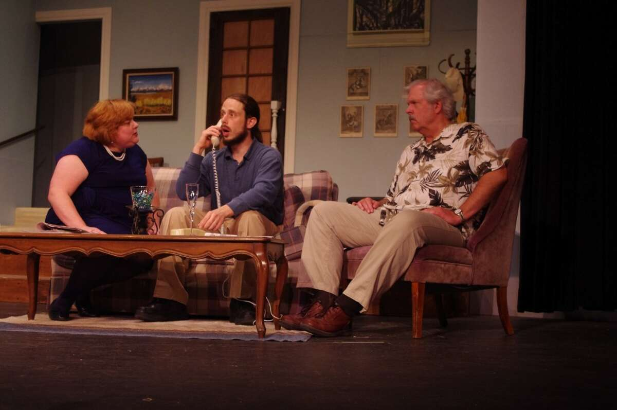 Jerry Sloan, on the telephone, played by Scott Fransee, learns that his mother's home just burned down and she will be moving into their apartment. Actors (from left to right) are Kathleen Miehlke who plays Jerry's wife Alice, Francee, and Bill Iddings, who plays Alice's father Abe Dreyfus. (Dave Yarnell/News Advocate)