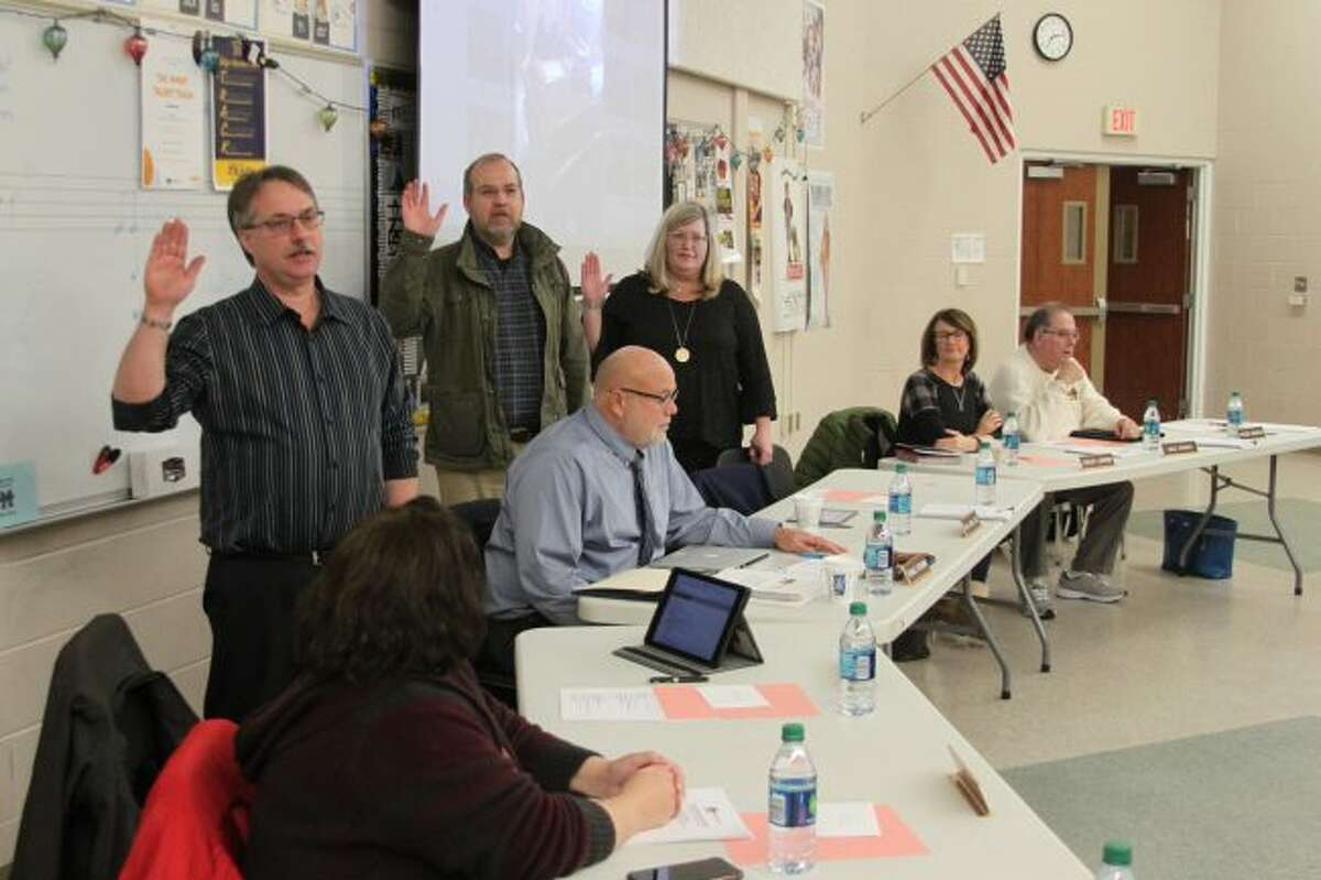 Manistee Area Public Schools Board of Education members who were elected to a new six-year term in November take the oath of office at the board meeting. Shown (left to right) are Paul Wehrmeister, Dr. Paul Antal and Theresa Anderson.