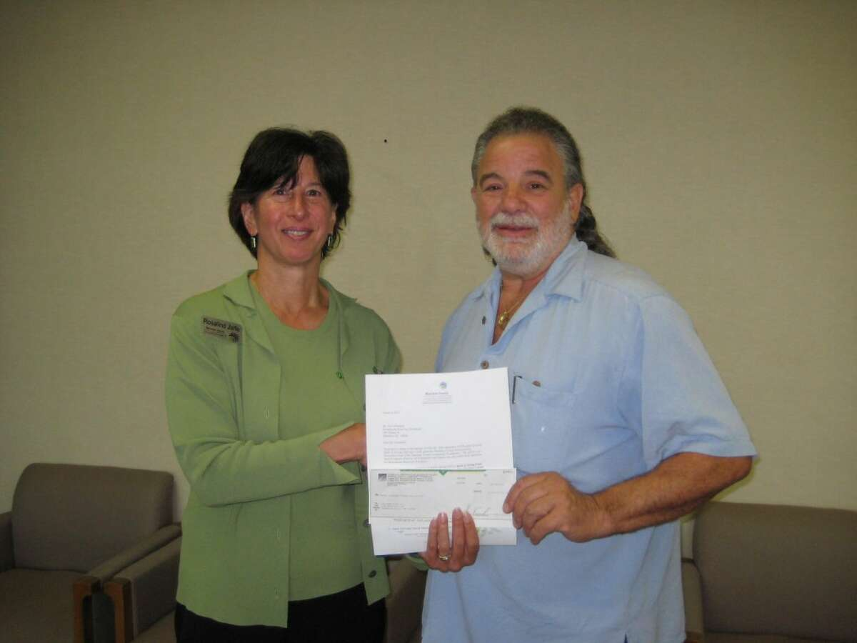 Community Foundation Board Chair, Rosalind Jaffe, presents a $760 mini grant award to Gregory Stone, executive director of STONESHOUSE. The grant will support STONESHOUSE's Recovery Residence in Manistee and their efforts to serve homeless individuals who also suffer from the disease of addiction. The grant was made possible by funding from the Foundation's Manistee County Homelessness Prevention Fund ($260) and Spirit of Giving Fund ($500).(Courtesy photo)