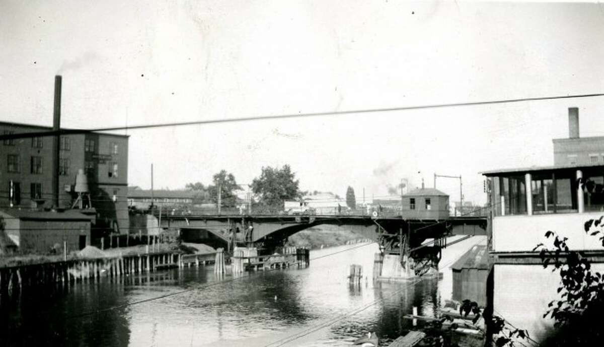 The former Maple Street Bridge circa 1920s. Since the mid-1800s, the Maple Street Bridge has been rebuilt in different forms, four different times.