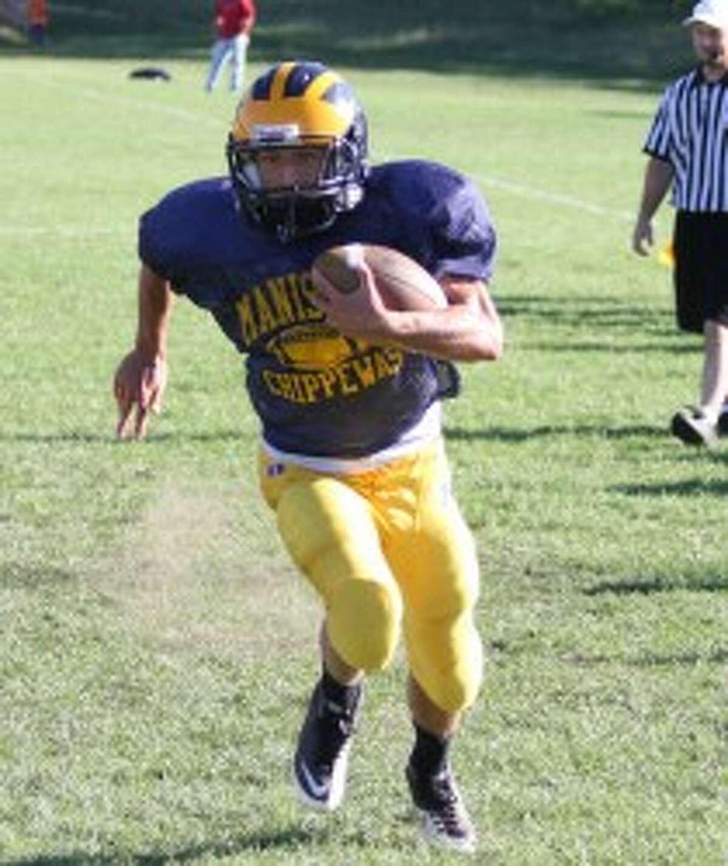 Manistee senior quarterback Evan Slawinski ran for three scores and tossed a pair on Friday. (Matt Wenzel/News Advocate)