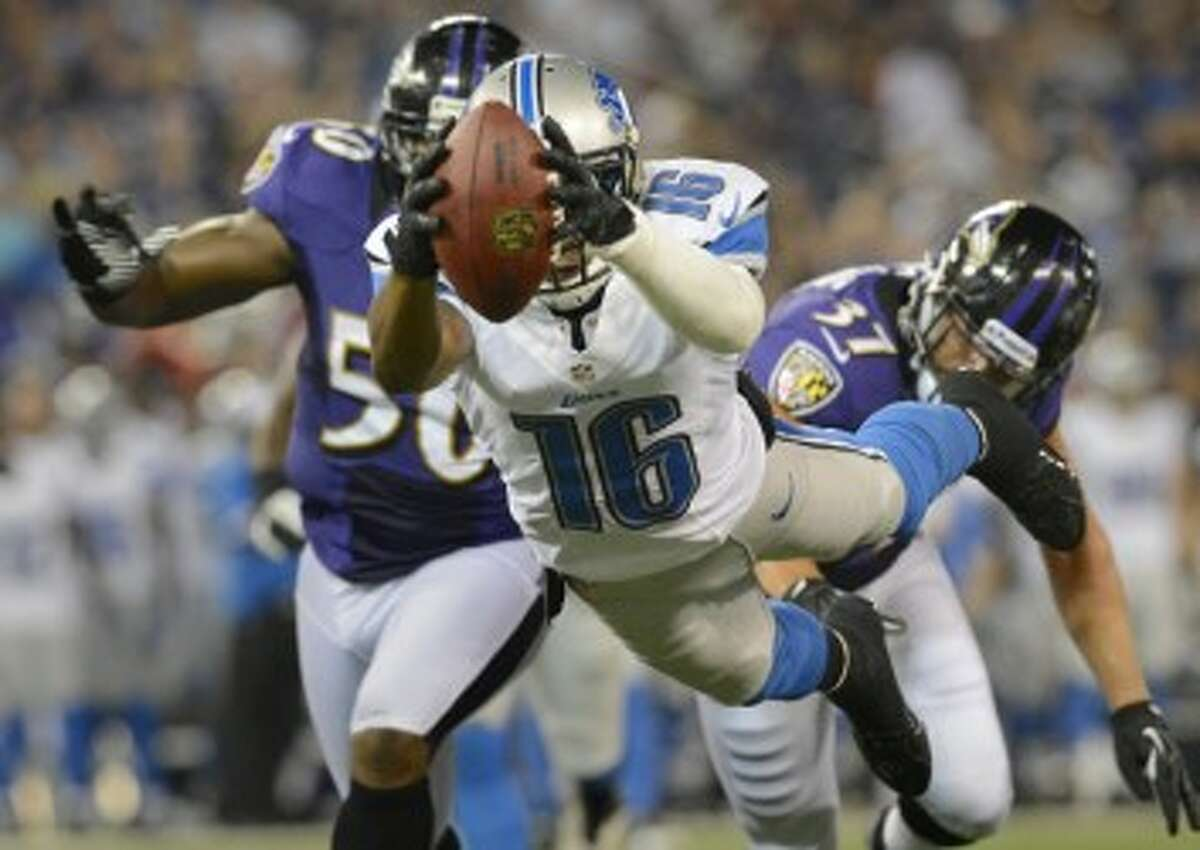 Lions receiver Titus Young dives into the endzone during a preseason win against the Ravens on Friday. (Doug Kapustin/MCT)