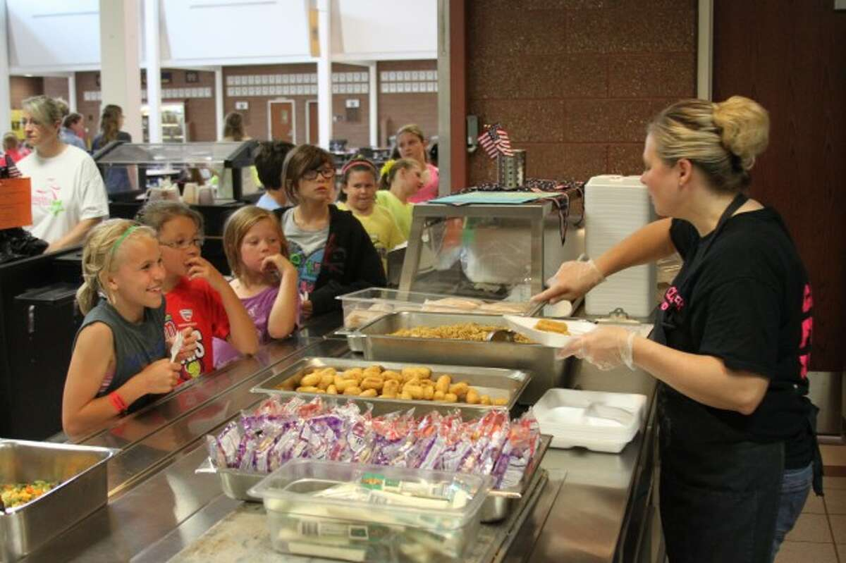File photoSchool breakfast and lunch programs in Michigan will be changing for the 2014-15 school year as schools are required to meet higher requirements for grains and lower sodium. Area school food service directors are adapting their menus to meet the requirements.