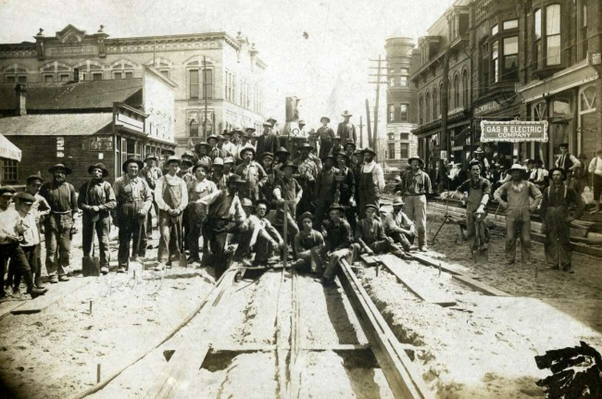 Constructing the tracks which would allow the street cars to ride on circa 1890s.