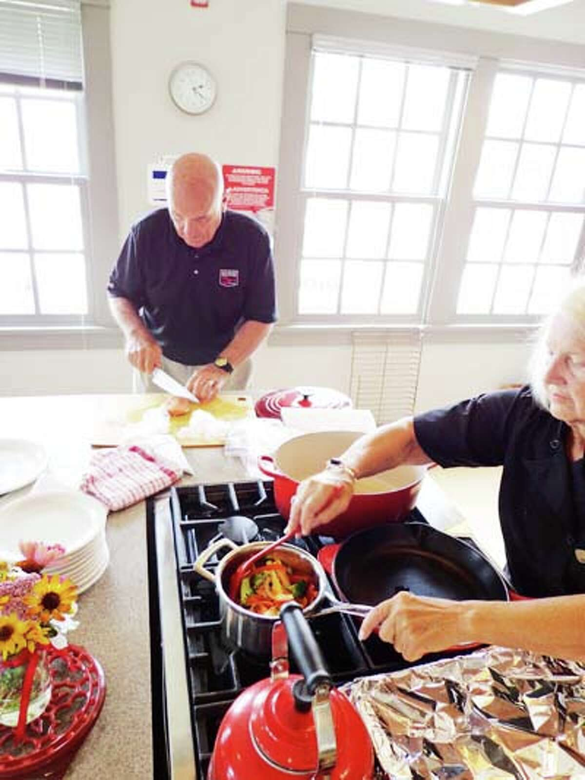 COOKING CLASS: ChefJoe Muer works in the kitchen at the Oliver Center of the Arts in downtown Frankfort. He will be leading a series of cooking classes that the center will be hosting in the coming weeks for parents and children alike.