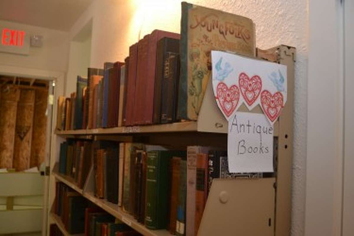 The Book House, a building operated by the Friends of the Manistee County Library, contains shelves full of many types of books, including antique volumes. (Meg LeDuc/News Advocate)