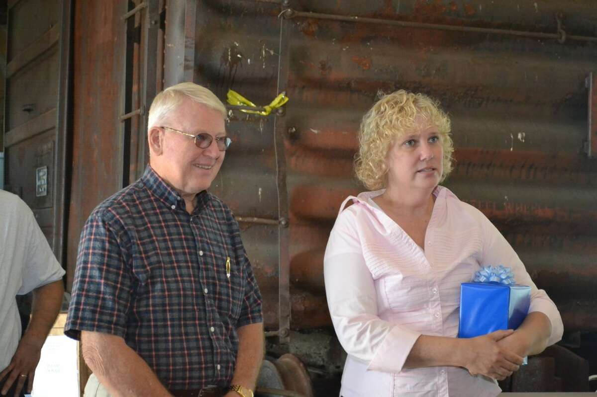 Linda Spencer (RIGHT), S.S. City of Milwaukee manager, honors longtime volunteer, board member and donor Dwayne Nugent (LEFT) at the annual carferry reunion on Saturday. (Meg LeDuc/News Advocate)