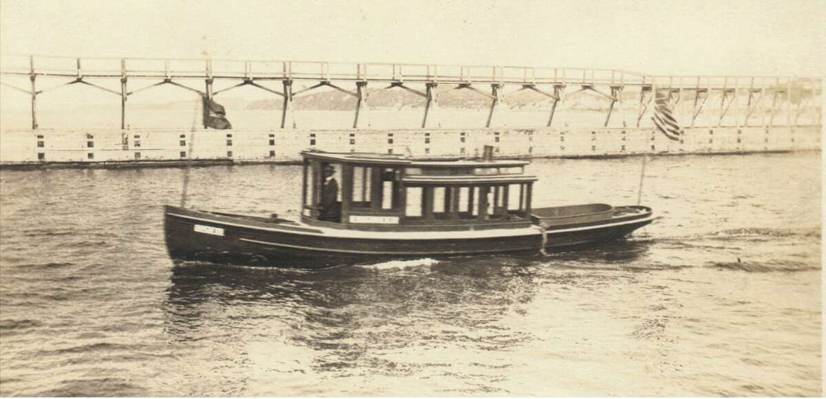 An early 1900s photo of the government inspector's boat in the Manistee harbor. (Courtesy Photo/Dale Picardat)