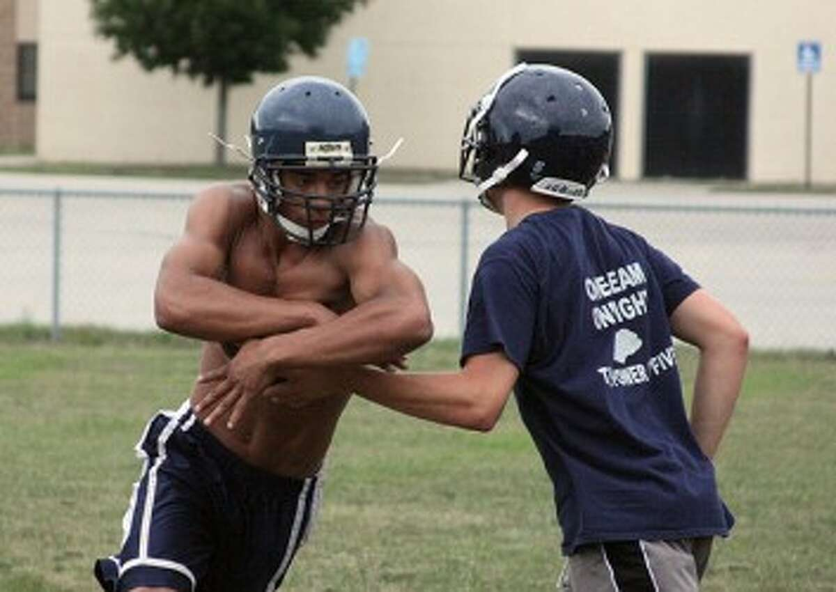Brethren's James Connolly takes a handoff during practice on Monday. (Dylan Savela/News Advocate)