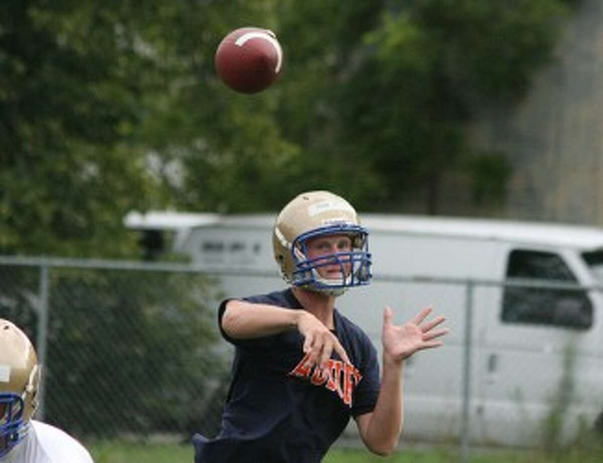 Onekama quarterback Tyler Johnson makes a throw during the first day of practice on Monday. (Dylan Savela/News Advocate)