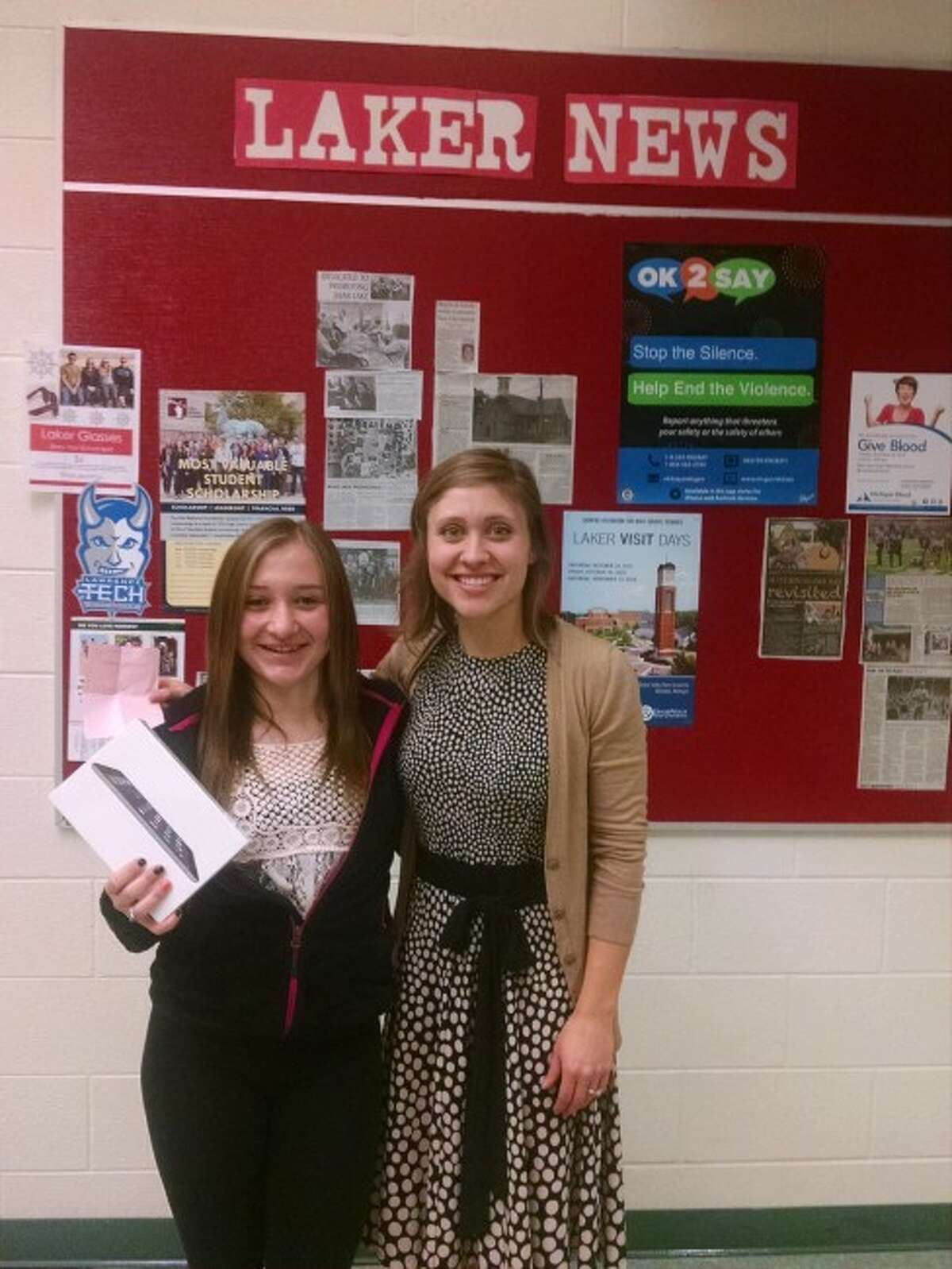 Bear Lake student Halie Clarke receives her iPad mini for the Launch Manistee College Application process from Leah Wachlin, Launch Manistee AmeriCorps/Vista associate.