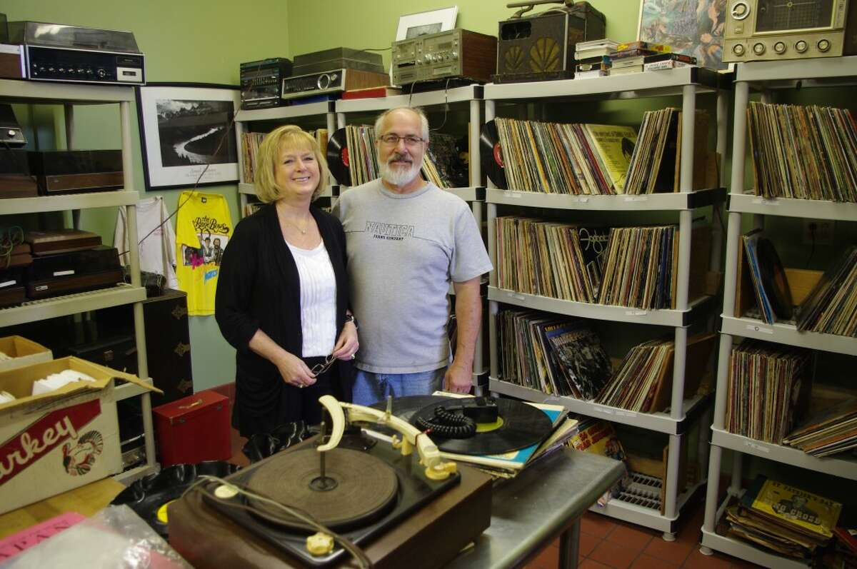Sally and John Dalke in their new store, Play It Again Johnny, on River Street in Manistee. The name comes from the record albums that are available in the store, part of John Dalke's collection of over 30,000, along with antique electronics, cameras and other items. (Dave Yarnell/News Advocate)
