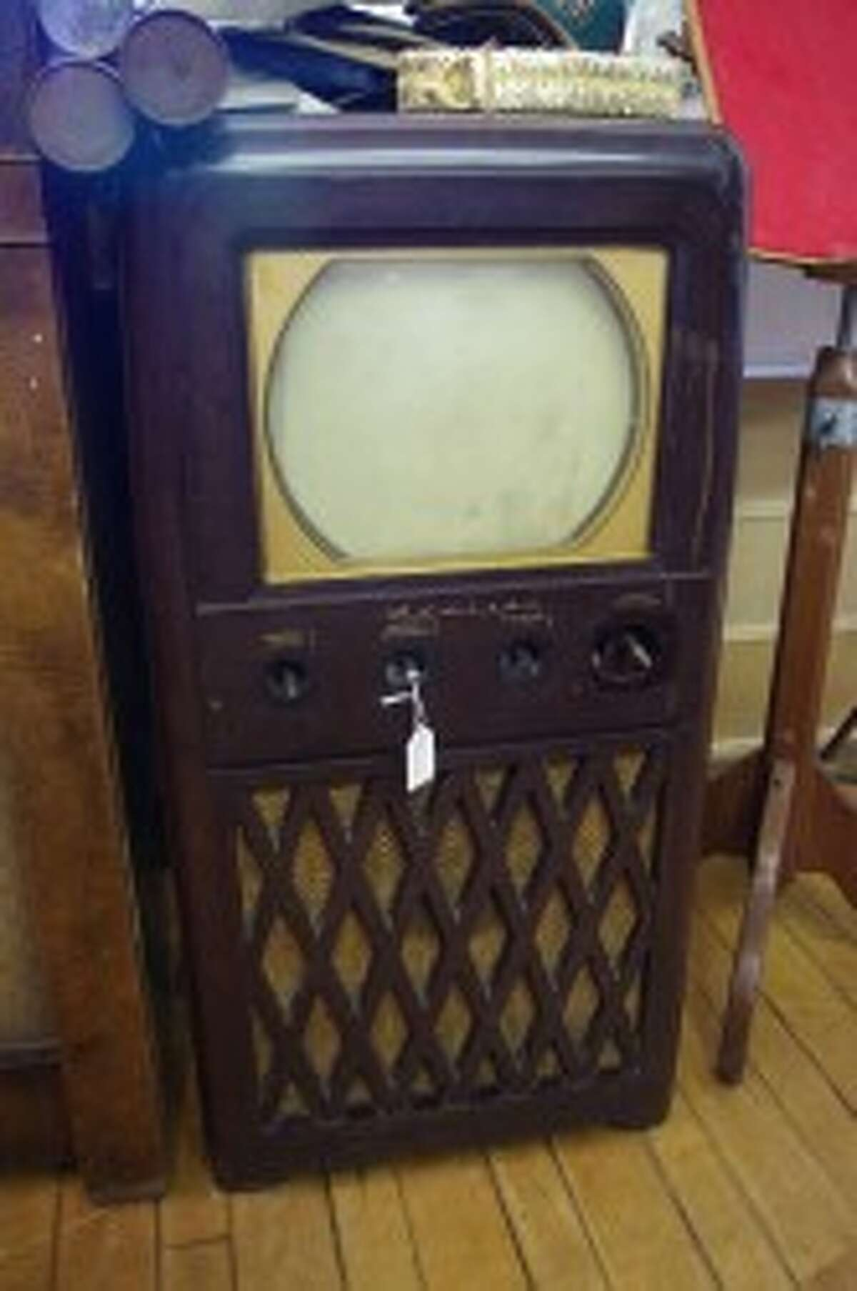 This antique television is one of the items collected by John Dalke over the years that is now for sale at Play It Again Johnny in downtown Manistee. (Dave Yarnell/News Advocate)