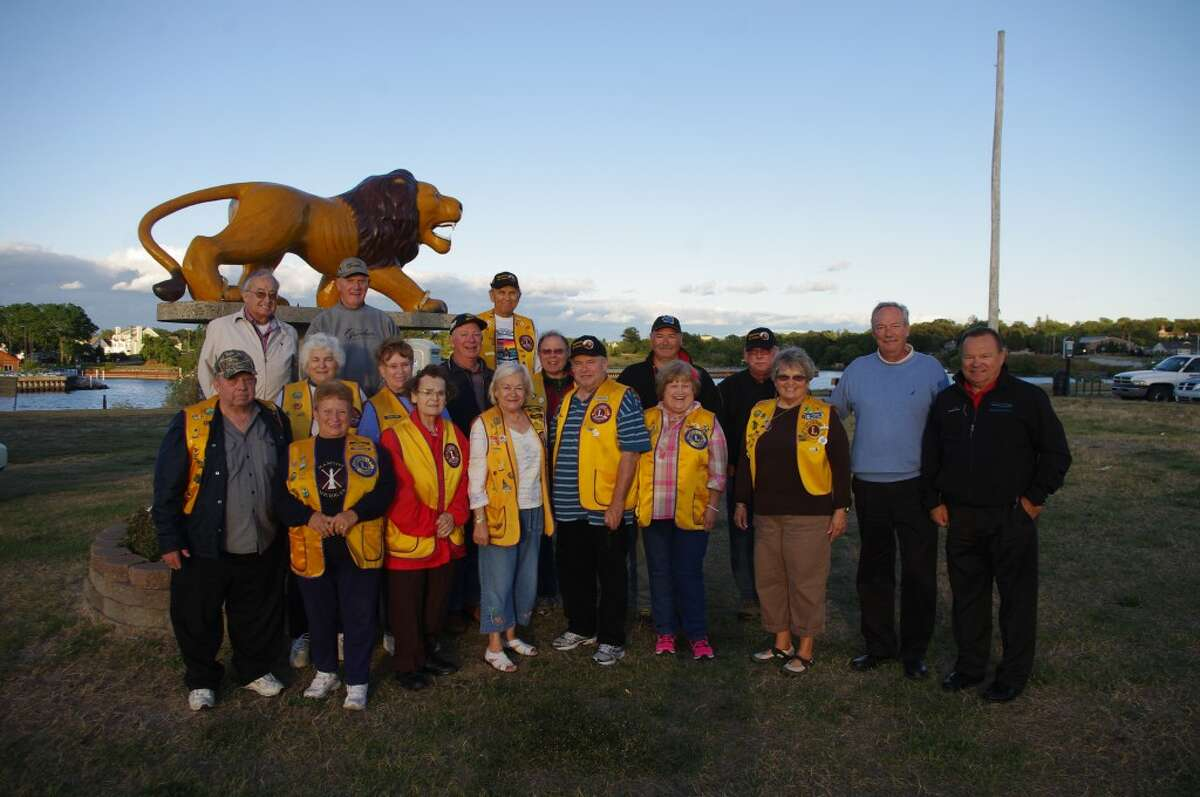 Members of the Manistee Lions Club gathered around the lion sculpture at Douglas Park First Street Beach after receiving a $5,000 contribution from the Consumers Energy Foundation to help fund the refurbishment of the picnic pavilion there. At the right are Robert Gluszewski, area manager for Consumers Energy, and Jim Pomaramski, Consumers Energy vice president of major projects construction. (Dave Yarnell/News Advocate)