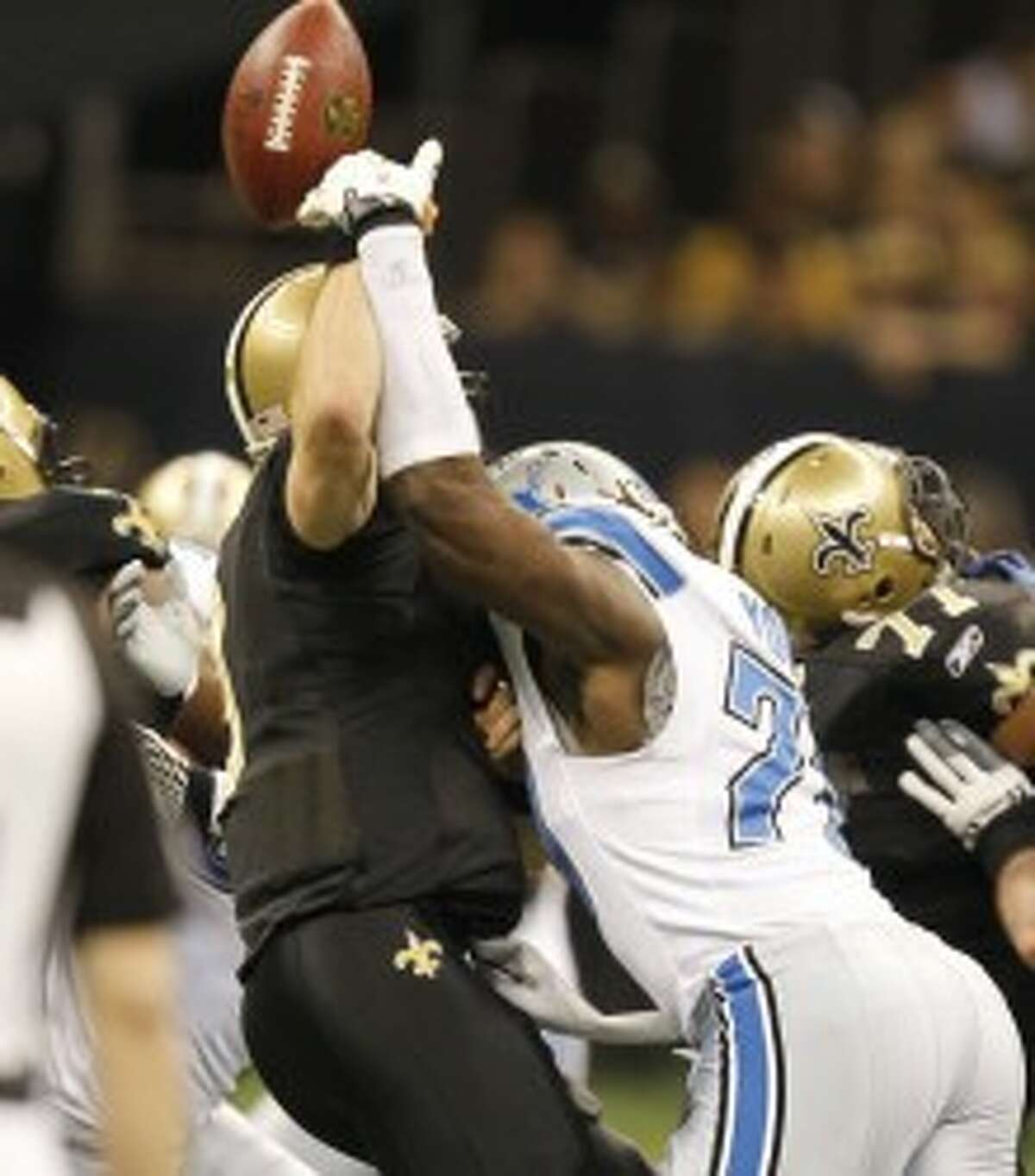 Lions defensive end Willie Young (right) hits Saints quarterback Drew Brees during an NFC wild card playoff game on Jan. 7. (Julian H. Gonzalez/Detroit Free Press/MCT)