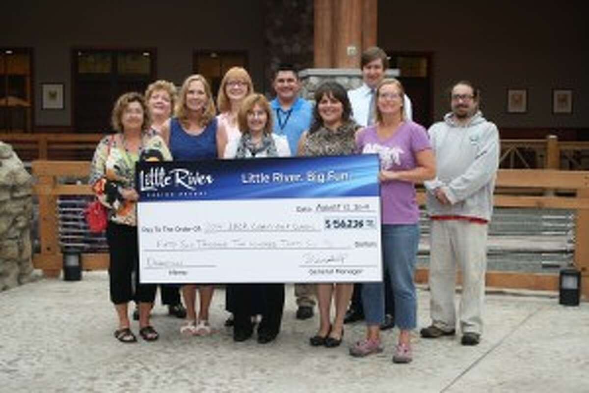 Representatives from LRBOI Indian Village Camp, Manistee Community Kitchen Café, Manistee County Humane Society, CASMAN Academy, Hospice of Michigan and the Chippewa 350 Club recently met with the Little River Casino Resort general manager Wendell Long (back right) to accept money raised at the LRCR annual charity golf outing.