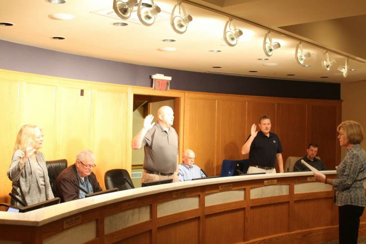 Council members Lynda Beaton (left), Chip Goodspeed (middle) and Mark Wittlieff (right) were sworn in Tuesday to the Manistee City Council during its annual organizational meeting on Tuesday in the council chambers at Manistee City Hall.