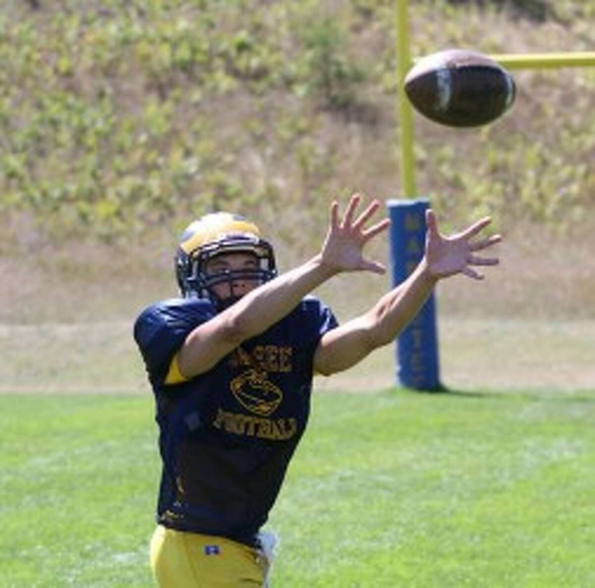 Manistee junior Jake Williams reaches out to attempt to catch a pass. (Matt Wenzel/News Advocate)