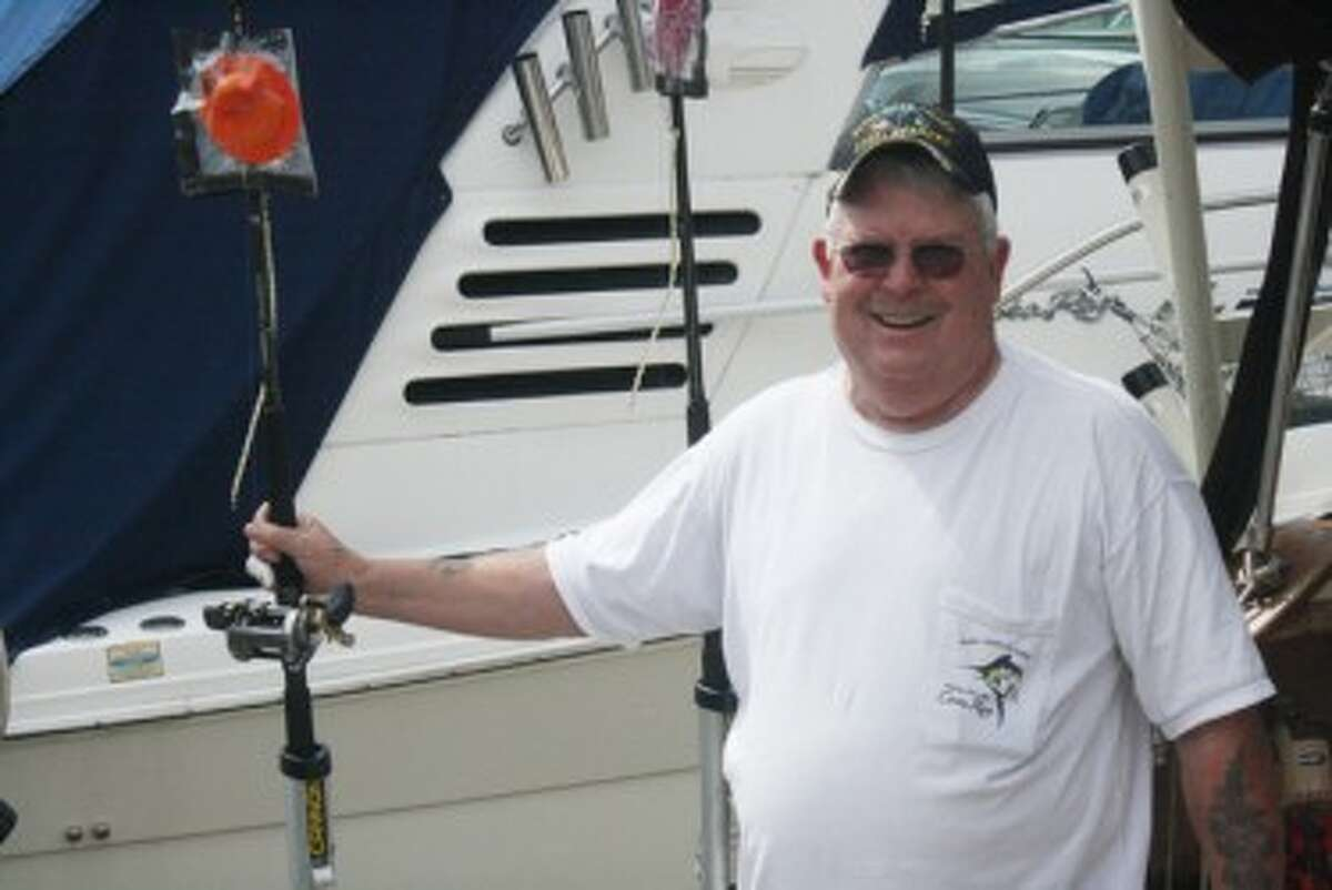 Mike Coe gets ready to work on his boat at Shipwatch Marina. (John Raffel/Pioneer News Network)