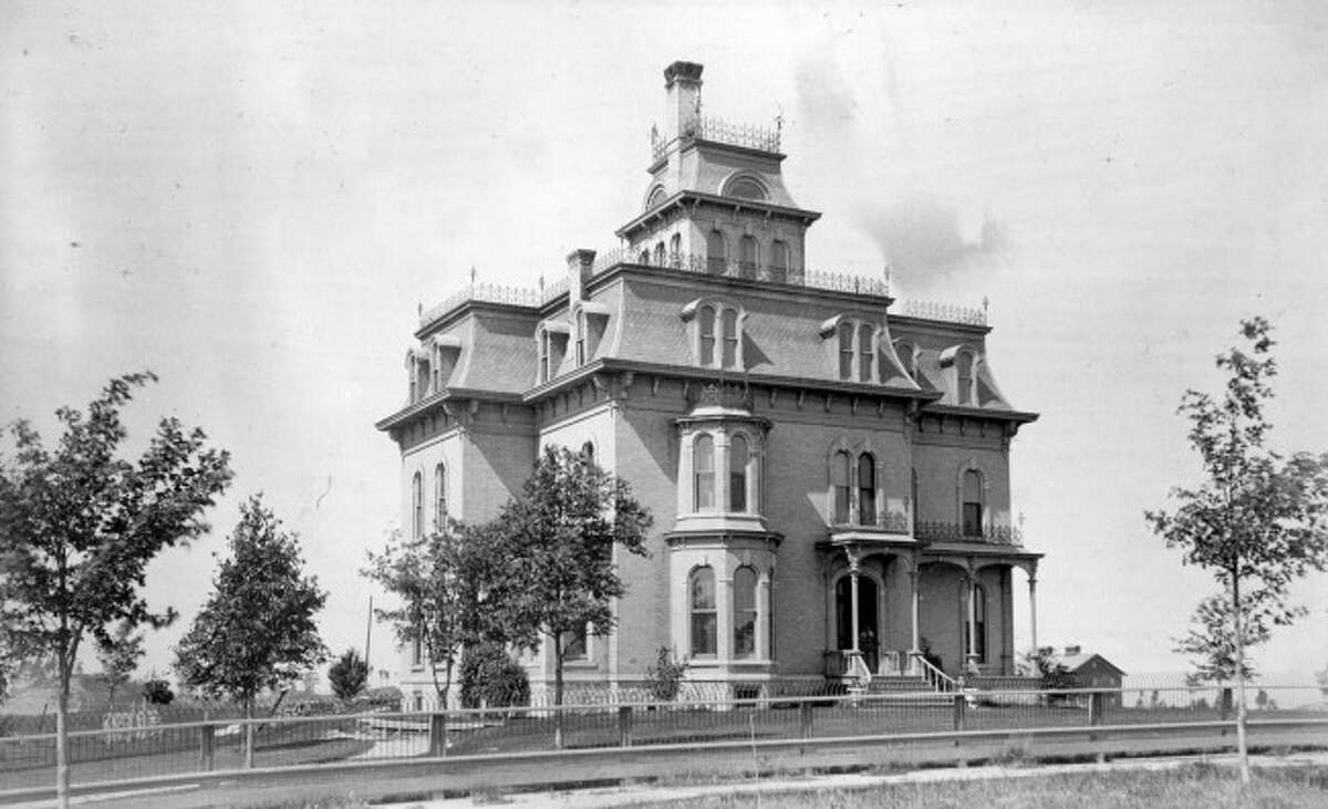 The home of Manistee lawyer and philanthropist, T.J. Ramsdell was constructed in 1875 on Cedar Street. In 1929, the once extravagant structure was destroyed by fire.