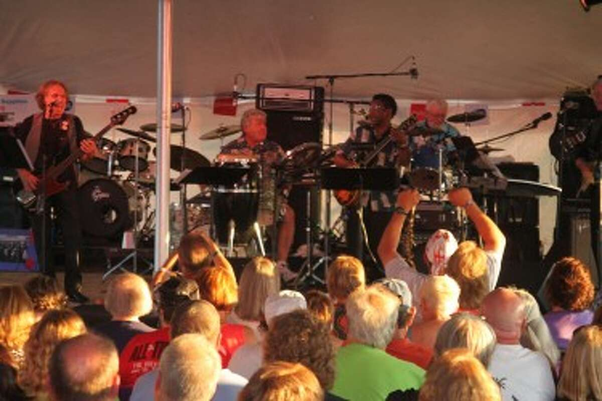 Band X (shown), Red Apple Road and Bo White and the Bluezers reunited on July 5 to play the Salt City Rock & Blues Reunion, which raised $10,000 for the restoration of the Manistee North Pierhead Lighthouse.