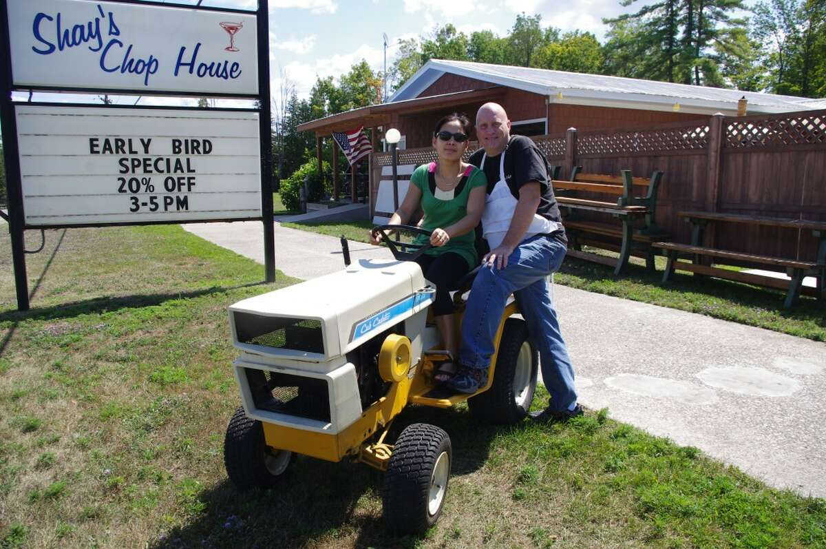 Aloha and Rick Shay get ready for the Onekama Benefit Hill Climb, a garden tractor ride from their restaurant to the Manistee County Fairgrounds. It will start at 6 p.m. on Aug. 23. (Dave Yarnell/News Advocate)